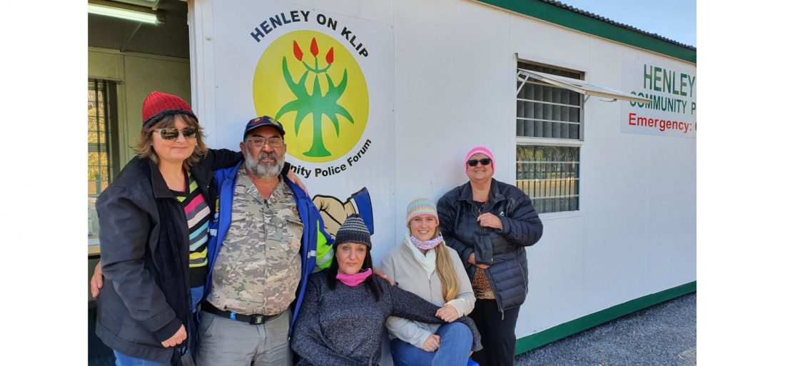 Members of the HCPF show off the beanies knitted for patrollers by Drienie Naude (right)